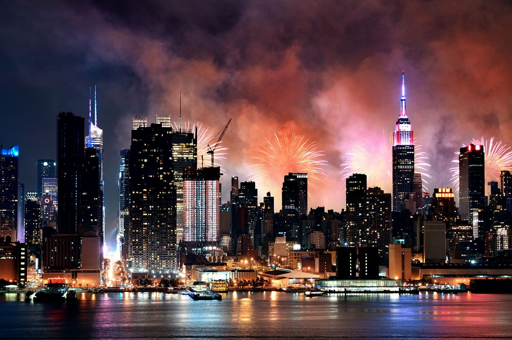 62003334 - fireworks show with manhattan midtown skyscrapers and new york city skyline at night